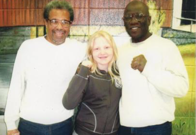 Albert Woodfox (left) and Herman Wallace (right) with an 11 year old British visitor, Poppy Richards.