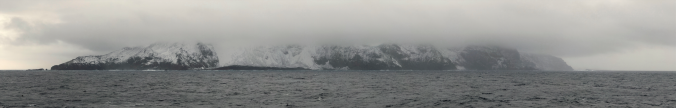 "Bouvet Island: ""A speck of ice in the middle of a freezing fastness: a few square miles of uninhabited volcanic basalt groaning under several hundred feet of glacier, scraped raw by gales, shrouded by drifts of sea-fog, and utterly devoid of trees, shelter, or landing places."""