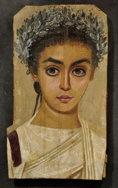 Many Fayum paintings – like this portrait of a girl dated to roughly 120-150 AD – feature subjects with abnormally large eyes. Are these paintings examples of Roman-era kitsch, the products of artists of limited talent – or a deliberate feature with religious overtones?
