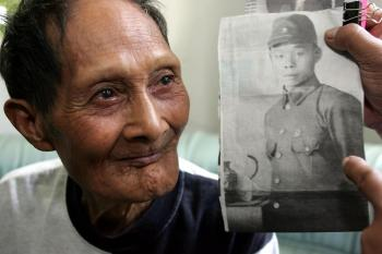 A wartime comrade identifies a contemporary photo of claimed Japanese holdout Tsuzuki Nakauchi.