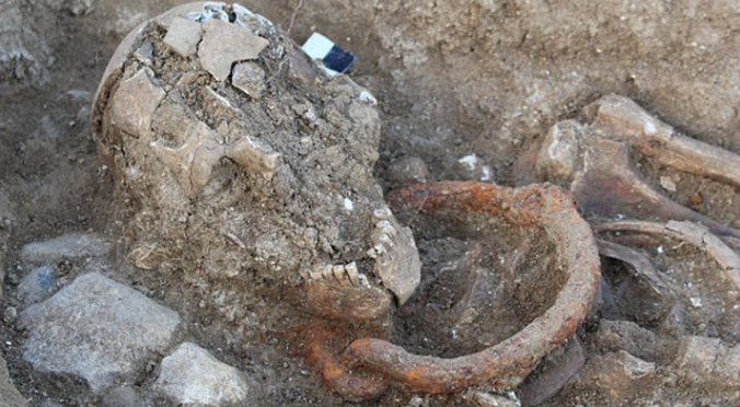 Buried in chains –a Roman-era skeleton, thought to be that of a male slave, excavated near Bordeaux. The body was buried with shackles around the neck, and dates from the 1st century AD.