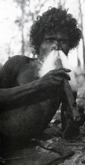 A man of the Narana tribe smokes a Makassan pipe.