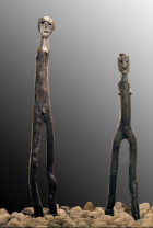 A pair of idols, one male, the other female, found at Ostholstein in Schleswig-Holstein and dating to 400 B.C. The male figure is 9 feet [2.75m] tall.